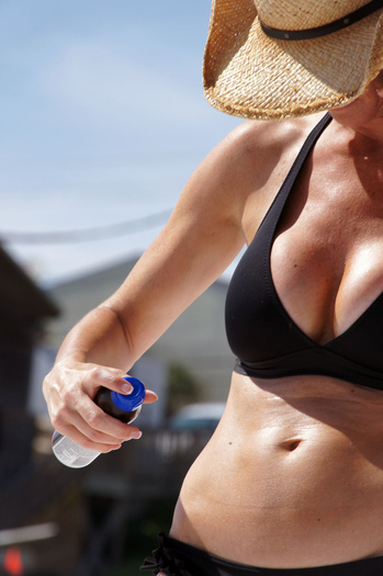 Photo: Spray-on sunscreen is one helpful option available to make sure you get thorough protection from the sun. Photo credit: JD Harvill.
