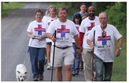 PHOTO: Adam O'Neal, center, mayor of Belhaven, N.C., will complete his walk from his hometown to Washington, D.C., on Monday. His aim is to call attention to the need for states to expand Medicaid, to cover more people and improve the financial stability of rural hospitals that treat them. Photo courtesy of O'Neal.