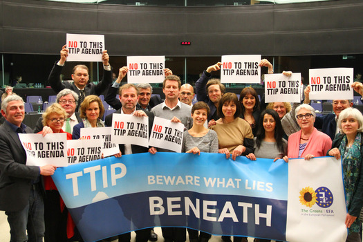 PHOTO: Those opposed to the Transatlantic Trade and Investment Partnership (T-TIP) protested during negotiations in March in Brussels, Belgium, where the latest round of talks is under way this week. Photo credit: Greens / European Free Alliance / Flickr.
