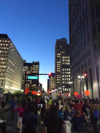 PHOTO: Many Michiganders have joined the cries of those in Ferguson, Missouri for an end to police brutality, including hundreds who recently gathered in Detroit's Hart Plaza and marched up Woodward Avenue. Photo credit: D. Holland.