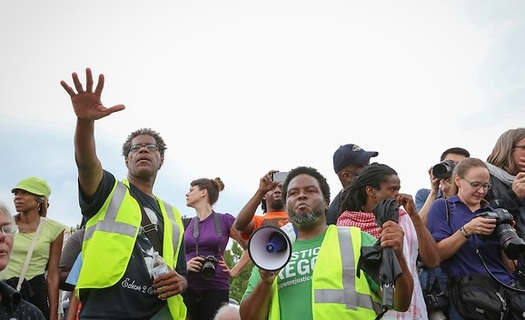 PHOTO: With continued unrest in Ferguson, Missouri, prayer vigils in Ohio were held to call for justice in the shooting death of Michael Brown. Photo courtesy of Heather Wilson, PICO National Network.