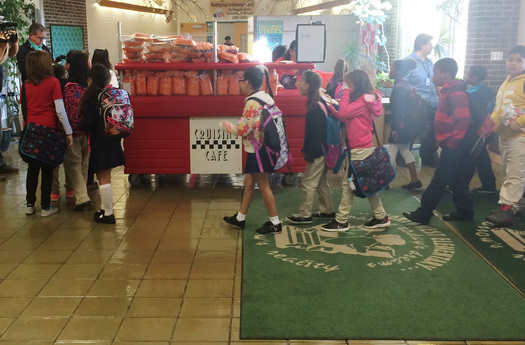 PHOTO: Elementary school students in Reading stop by kiosks parked near school entrances to get free, nutritious breakfast items to eat in their classrooms. Photo courtesy Food Research and Action Center.