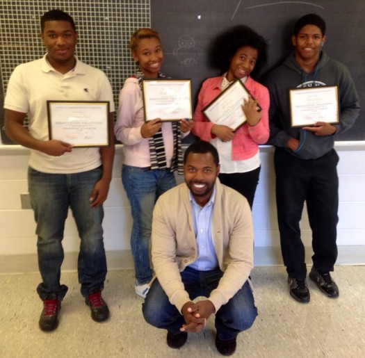 PHOTO: AFSC Peace Education Director Joshua Saleem, front, with four students honored for their Peer Mediation Program work at Northwest Academy of Law in St. Louis. Photo courtesy of American Friends Service Committee.