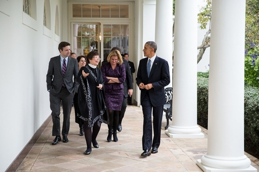 PHOTO: President Obama walks with senior advisers on the Colonnade of the White House. He's been receiving pushback all week about an executive order on immigration announced on Thursday. Photo credit: Pete Souza, WhiteHouse.gov