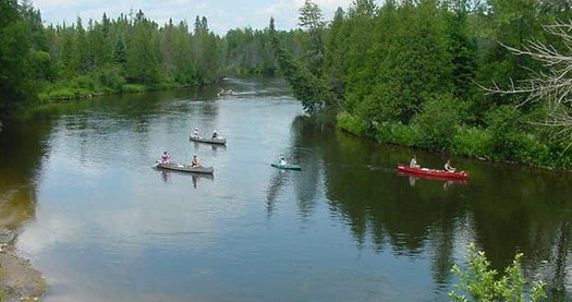 PHOTO: People come from around the country to enjoy Michigan's Au Sable River, which is why one group wants the federal government to study the potential risks of a 60-year-old oil pipeline that runs beneath it. Photo courtesy of Wikimedia Commons.