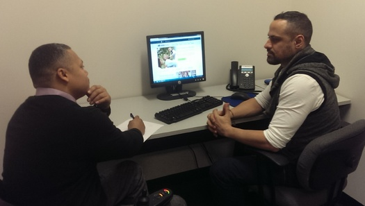 PHOTO: CIDNY counselor advises consumer on insurance options. Courtesy: CIDNY