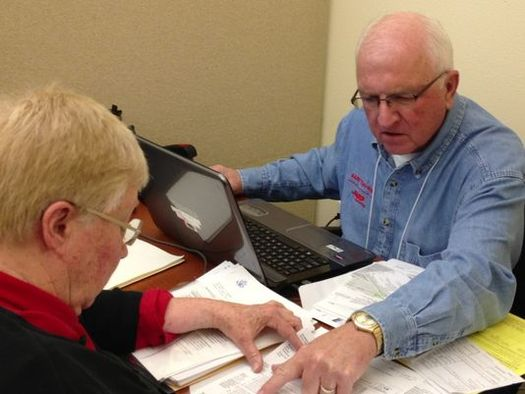 PHOTO: AARP Tax Aide volunteers are available at sites throughout the state to help eligible Illinoisans prepare their state and federal tax returns. Photo courtesy of AARP.