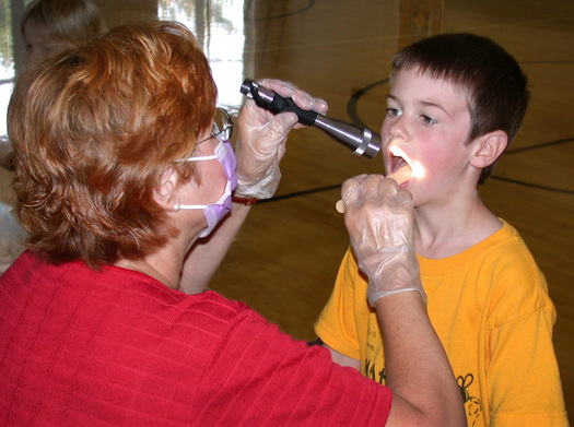 PHOTO: Getting children to brush their teeth and floss, and reminding parents of how the importance of oral health, are the goals of National Children's Dental Health Month. Photo courtesy North Carolina Department of Health and Human Services.