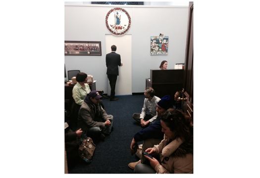 PHOTO: Immigration activists await the arrival of Capitol Hill police in the office of Virginia congresswoman Barbara Comstock. Photo credit: Julie Karant.