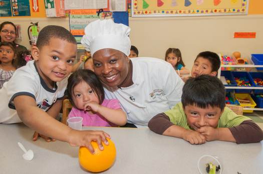 PHOTO: Project Bread's Chef Vanessa LaBranche with students is part of the outreach that is moving the Commonwealth out of the basement when it comes to participation in school breakfast. Courtesy: Project Bread