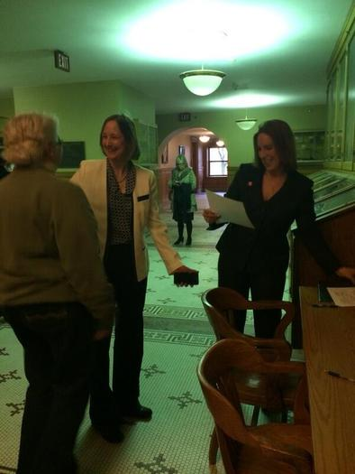 PHOTO: Glenna DeJong and Marsha Caspar, shown here with Ingham County Clerk Barbara Byrum on their wedding day, were the first same-sex couple in Michigan history to legally wed. They will celebrate their first anniversary this weekend by continuing to fight for marriage equality in the state. Photo courtesy of B. Byrum.