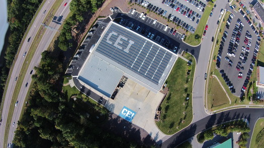 Photo: CEI's building is in the flight path of Raleigh International Airport. The company used it as an opportunity to market its company name with the layout of its solar panels. Photo courtesy: CEI