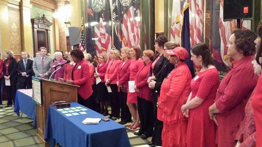 PHOTO: Women are not worth less. That's the message supporters of equal pay legislation will once again bring to the Michigan Capitol today, wearing red to symbolize the fight to get women's salaries out of the red. Photo courtesy of Michigan Equal Pay Coalition.