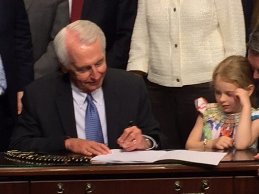 PHOTO: Kentucky Gov. Steve Beshear signs House Bill 8, legislation that extends civil protection orders to dating partners, but doesn't go into effect until Jan. 1. Photo by Lisa Gabbard.