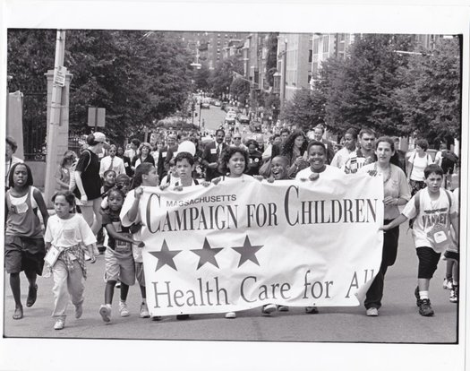 Health Care For All's 1996 victory march after state lawmakers passed legislation creating MassHealth and expanded coverage for kids. The group's 30th anniversary will be celebrated tonight in Boston. Courtesy: Health Care for All.