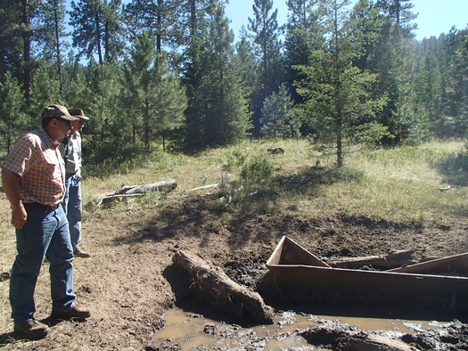 PHOTO: NRCS Earth Team volunteer Shawn McKay (front) talks with a rancher in Union County about options to redevelop a livestock watering system and help protect a stream that provides important salmon habitat. Photo courtesy National Resources Conservation Service.