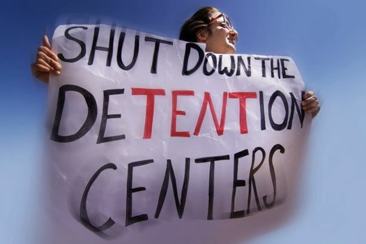 PHOTO: On Saturday, several hundred people converged on the family detention camp in Dilley, Texas, to call for an end to the policy of locking up refugee parents and children. Photo credit: Austin Indymedia.