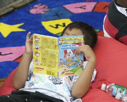 PHOTO: Reading during summer vacation is critical for students to maintain their academic skills and avoid what educators call summer brain drain.  Photo credit U.S. Department of Education.