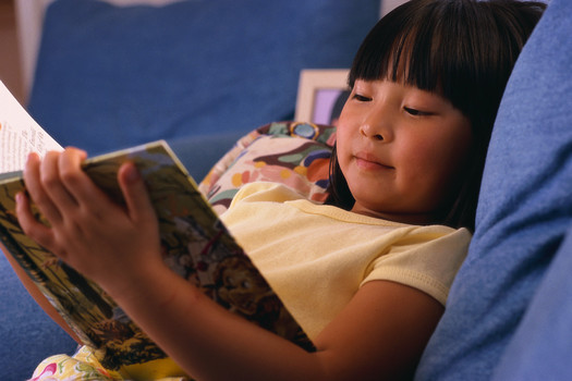 PHOTO: Reading during summer vacation is critical for students to maintain their academic skills and avoid what educators call summer brain drain. Photo credit U.S. Department of Health and Human Services.