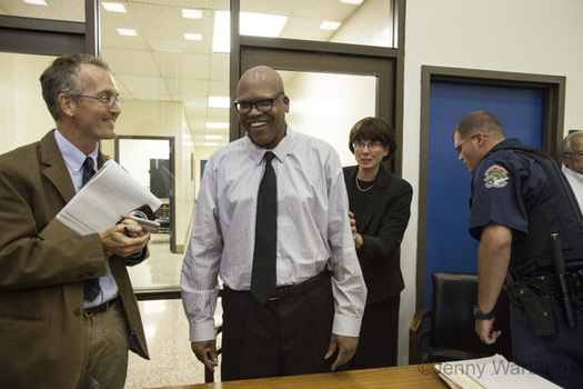 Photo: Leon Brown (center) and Henry McCollum received a pardon of innocence from Gov. Pat McCrory after spending 30 years on death row. Photo courtesty: Jenny Warburg