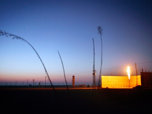 PHOTO: A flare burns at an oil field near Bakersfield. Environmental groups filed suit Wednesday to stop additional fracking and oil drilling on BLM land in California. Photo credit: Chris Jordan-Block/Earthjustice.