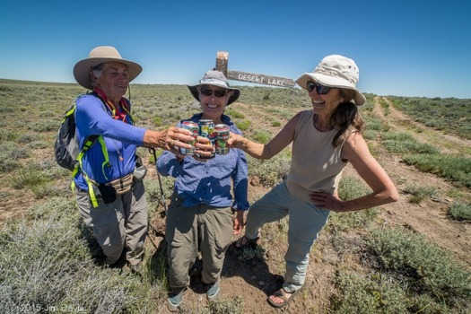 From left, Julie Weikel, Helen Harbin and Alice Elshoff toast the five days they spent hiking and camping in the southern Oregon and northern Nevada high desert. Credit: Jim Davis for Oregon Natural Desert Assn.