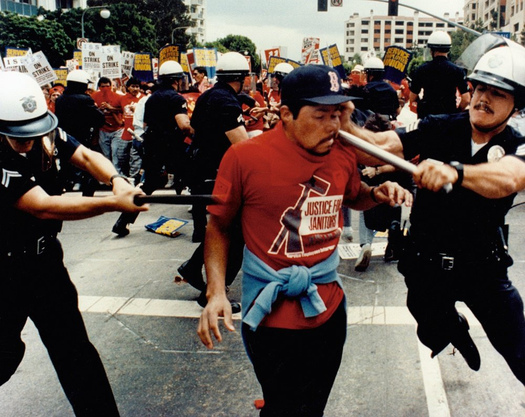 A striking janitor being clubbed by L.A. Police on June 15, 1990. Connecticut workers are marking the 25th annual Justice for Janitors Day with a march to Hartford City Hall on Wednesday. Courtesy: SEIU.