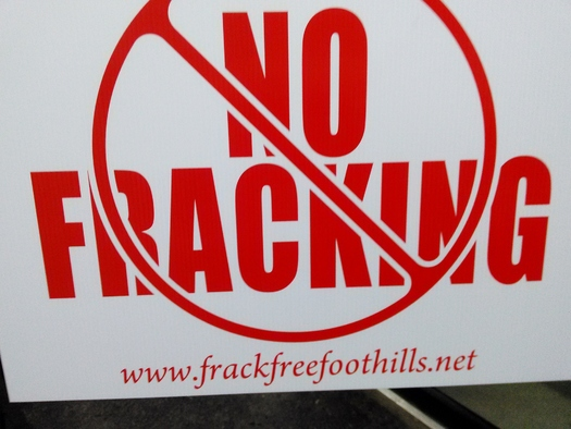 Landowners concerned about the impact of deep-well fracking in Kentucky are displaying signs like this one as the state moves forward with the controversial method of oil and gas drilling. Credit: Greg Stotelmyer.