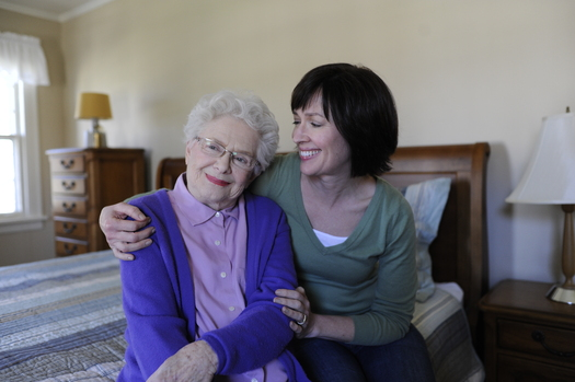 About 459,000 Oregonians are unpaid family caregivers for loved ones. Nationally, AARP estimates the value of this care rivals Wal-Mart's annual sales. Credit: Chris Kirzeder/Alzheimer's Association.