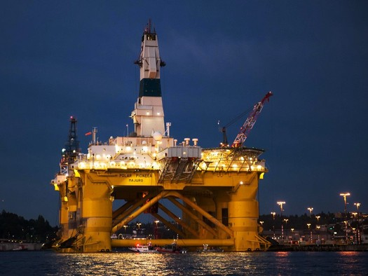 Shell's Polar Pioneer drilling rig arrived in the Seattle area to protests, and left Elliott Bay in mid-June. Credit: Jeff Dunnicliffe for The Backbone Campaign/Flickr.