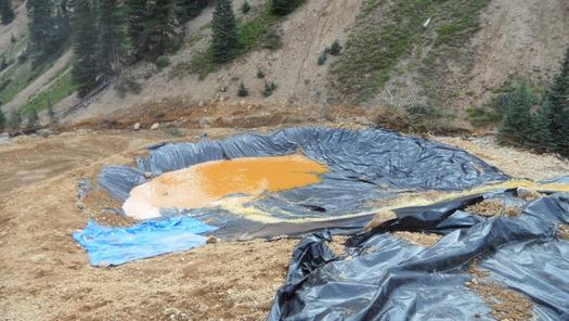 The EPA is treating contaminated waters in containment ponds such as this one. Credit:  U.S. Environmental Protection Agency