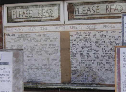 Messages cover the windows of a schizophrenic patient's house. Credit: Pete S/ Wikimedia Commons.