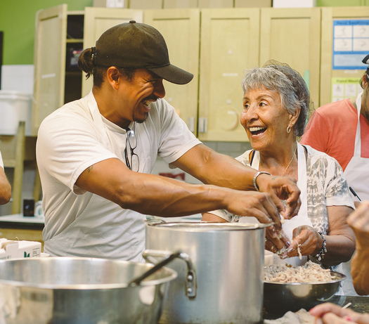 Hosting cooking classes is just one way that traditional food banks or soup kitchens can transform themselves into vibrant and welcoming community centers. Credit: The Stop, Toronto
