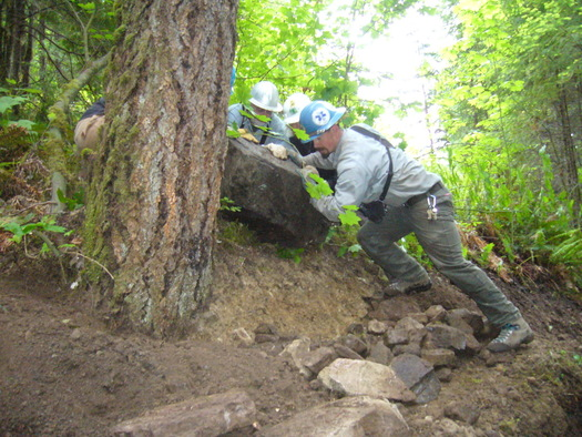 Not all National Public Lands Day projects require as much muscle as this one. Here, the Greater Oakridge Area Trail Stewards (GOATS) work on a rock retaining wall on the Willamette National Forest. Courtesy: U.S. Forest Service