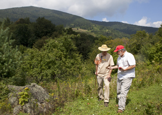 Doug Hundley, right, of the North Carolina Cooperative Extension Service visits Grassy Ridge, where an abandoned homestead farm was discovered. Courtesy: Doug Hundley