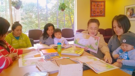 The Family Resource Center at Emma leads groups, including Motheread, which teaches the importance of reading between a mother and child. Norma Duran Brown leads the class (right). Credit: Children First/Communities in Schools