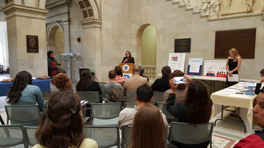 Amy Whitcomb Slemmer and other health care advocates released a new study at the State House showing many Hispanics in the Commonwealth missing out on insurance coverage. Courtesy: Health Care For All