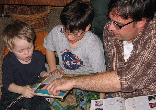 Helping parents help their young children makes a big difference in later years. Credit: Peter Merholz/Wikimedia Commons.