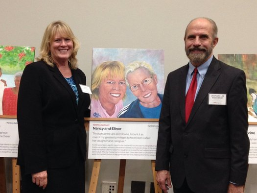 Nancy Madsen-Wilkerson, Utah's 2015 Portrait of Care honoree, with a painting of her and her mother. Credit: AARP Utah