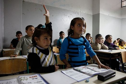 Syrian children continue to try to get an education in the midst of the conflict in their home country. Credit: UK Department for International Development/Wikimedia Commons