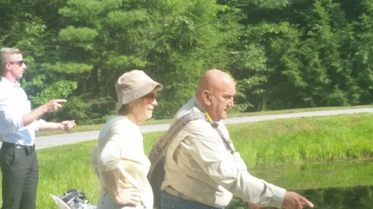 New Hampshire fishing guide Ron Sowa gives some fishing tips to Sen. Jeanne Shaheen, D-N.H. Today he is among those crediting the lawmaker for her vote this month that blocked Senate Bill 1104, which would have blocked protection of small rivers and streams. Courtesy: E. Orff.