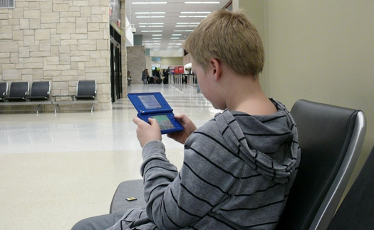 Research finds teens are using digital devices with screens for about nine hours a day. (Greg Stotelmyer)