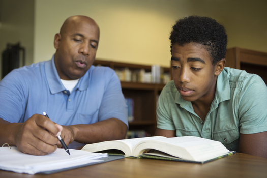 Several South Dakota mentoring services are looking for volunteers. (iStockphoto)