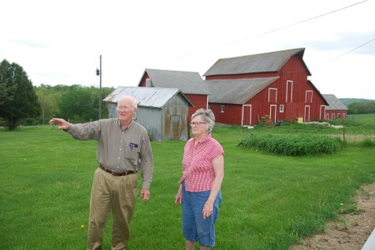 Dale Nimrod shows his wife Sonya around the family farm in southwest Iowa. He and his siblings recently sold the land to help a young couple establish their own family farm. (Practical Farmers of Iowa)