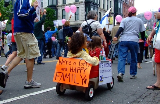 A family is part of a recent Gay Pride parade. A Utah legislator wants to give heterosexual families preference over gays in adopting children in the state. (Wikimedia Commons)
