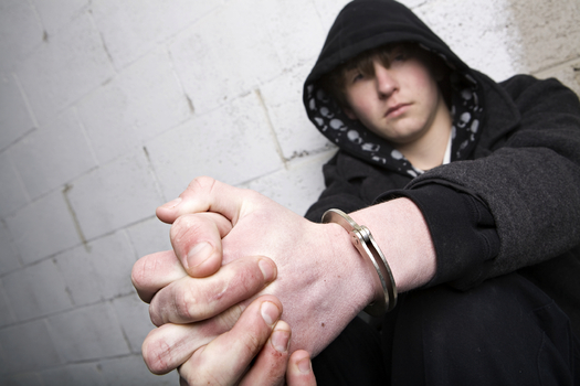 A new report details higher rates of incarceration and discrimination among the country's LGBT youth. (iStockphoto)