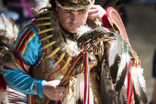 Dancer Joe Syrette of the Ojibwe tribe from Batchewana, Ontario, holds an eagle head staff during the Spring Powwow held on the UW-Madison campus last year. (Jeff Miller/UW-Madison Communications)