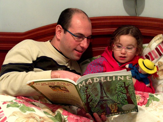 A University of Maine professor says families don't have to spend money on videos to introduce babies and young children to reading. It's as simple as sitting down with them daily to enjoy a book. (Ldorfman)