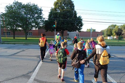 Walking School Bus programs encourage students to walk to class instead of riding in a bus or car. (American Heart Association)