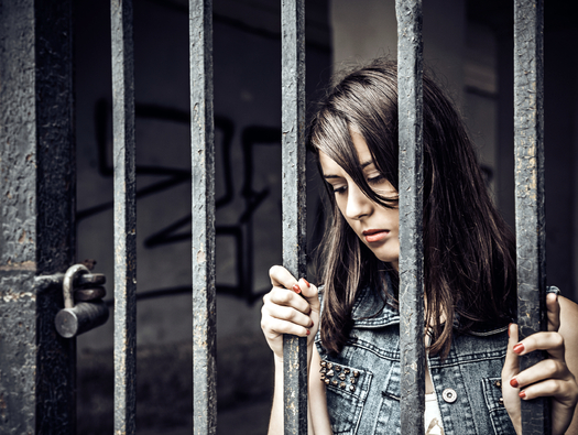 An estimated 477,000 children in Texas, and 5.1 million nationwide, spend at least part of their childhood with a parent who is incarcerated. (djsash001/iStockphoto)